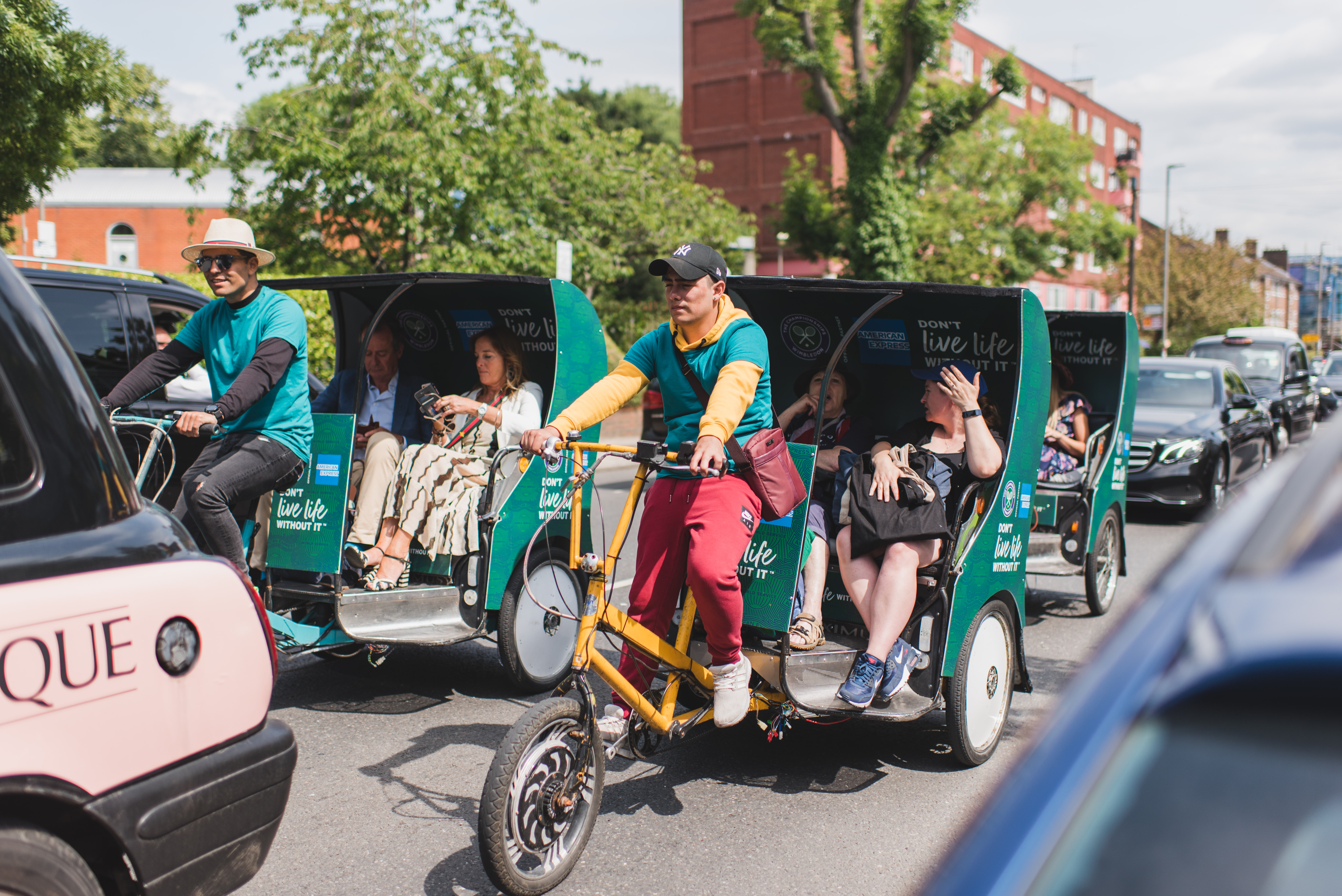 American Express pedal cabs transporting people to Wimbledon