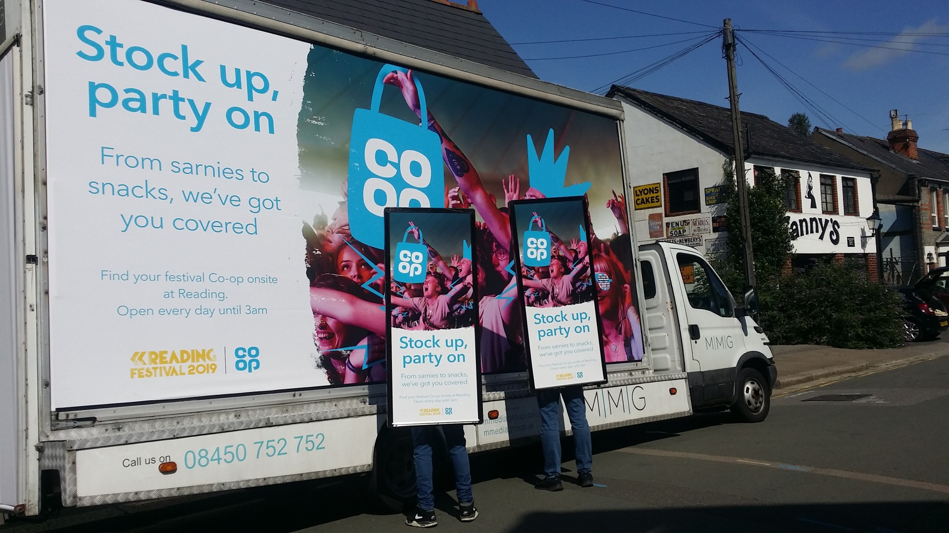 2 Co-op AdWalkers standing beside a Backlit Advan