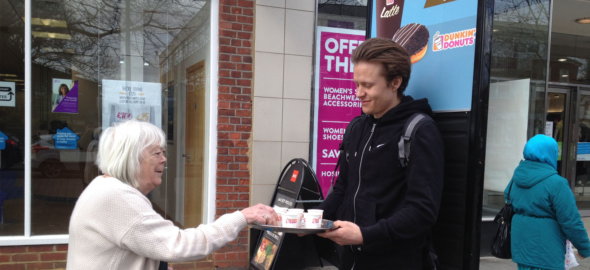 Advert walker giving out samples