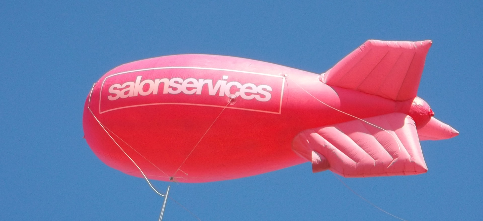 Salon Services advertising blimp in the sky