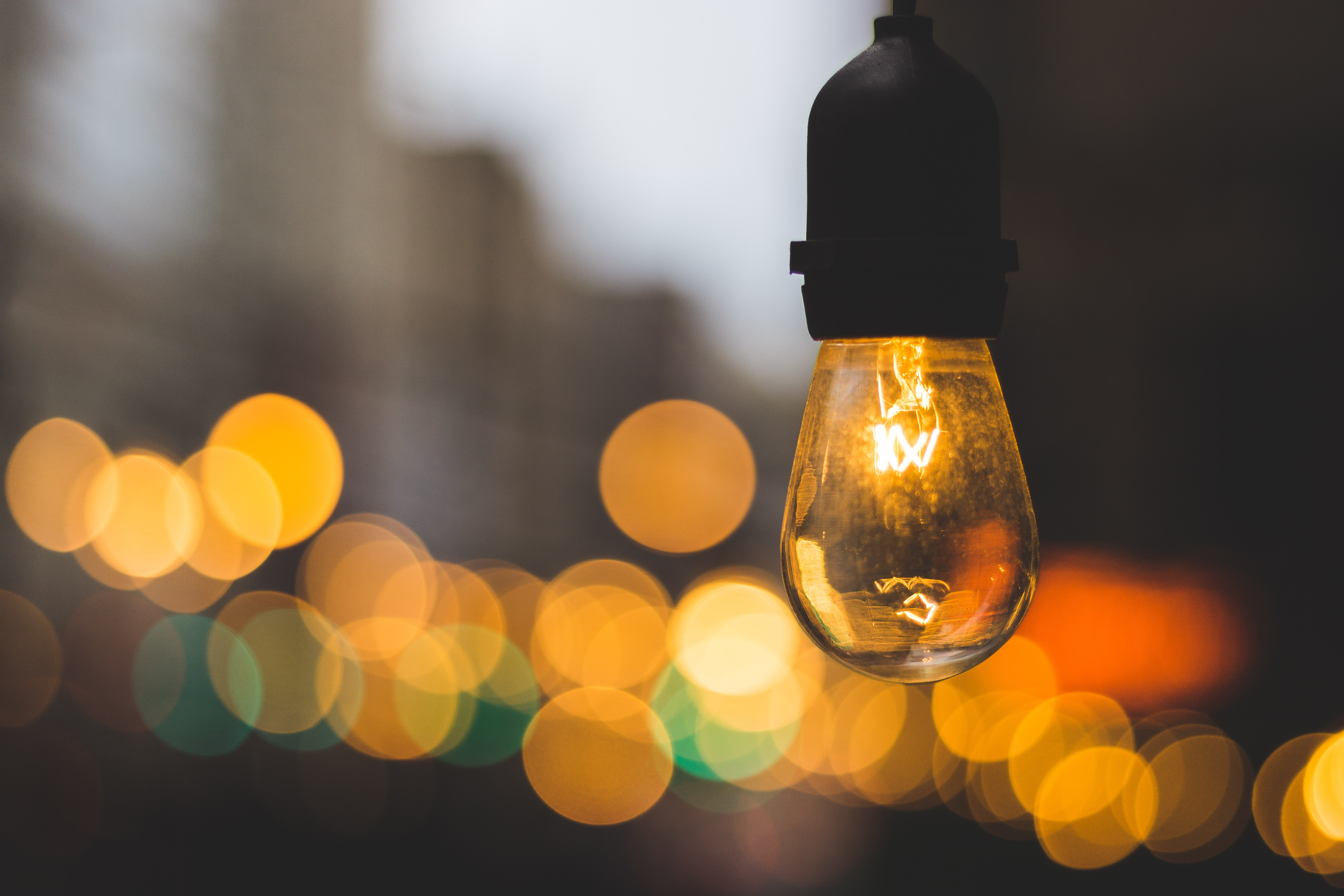 Light bulb on symbolising innovation and new ideas