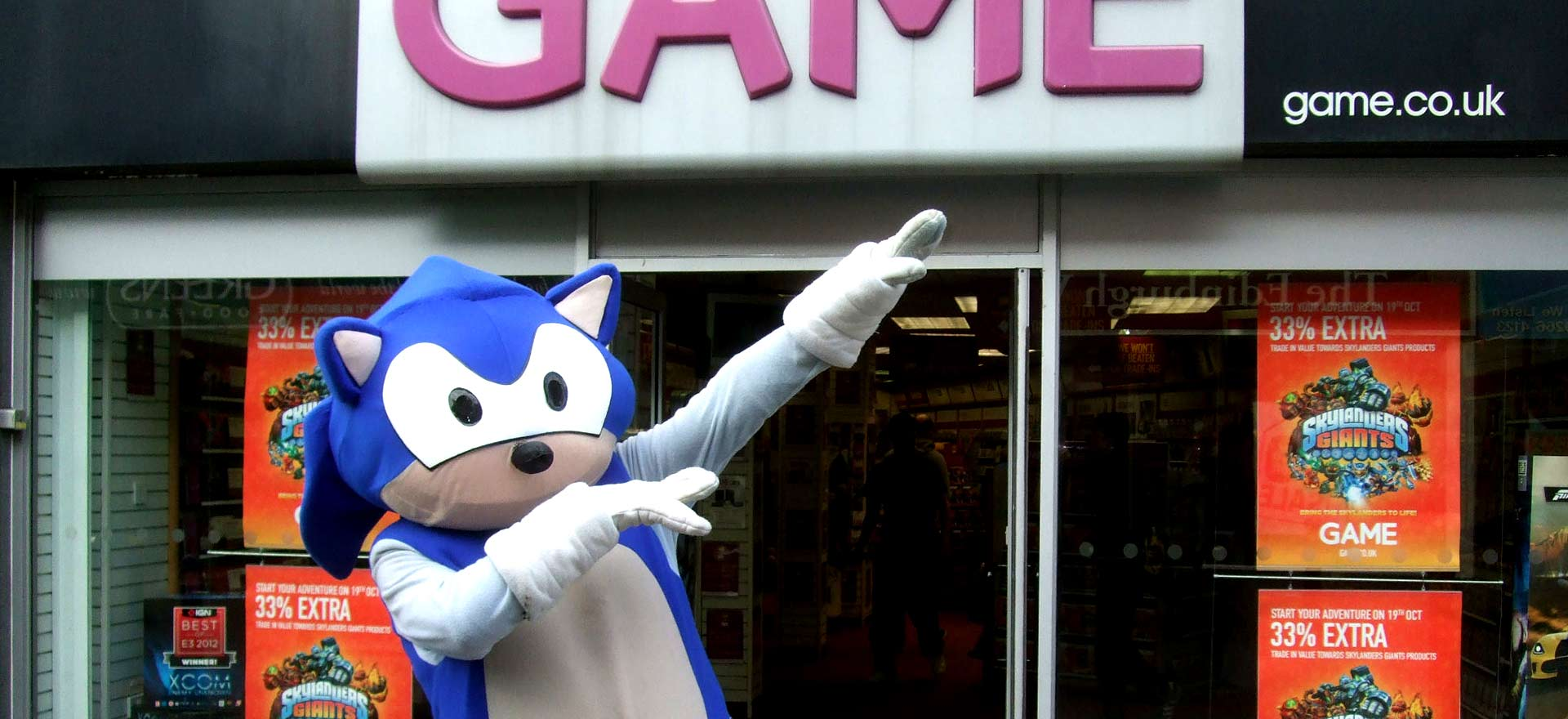 Sonic the Hedgehog mascot outside a Game store